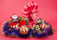 Christmas balls and purple tinsel Stock Photography