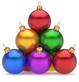 Christmas balls pyramid multicolored red leader on top hierarchy. Christmas balls pyramid multicolored red leader on top New Year`s Eve bauble group decoration Royalty Free Stock Photo
