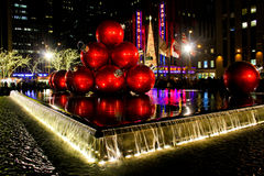 Christmas Balls and Radio City Music Hall. Two Manhattan landmarks, the Christmas Balls and Radio City Music Hall shine bright for all to see royalty free stock photography