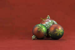 Christmas balls on a red background Stock Images