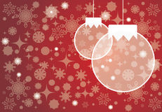 Christmas balls on red background. Christmas balls on the red background with snowflakes Royalty Free Stock Image