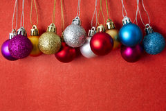 Christmas balls on a red background Royalty Free Stock Images