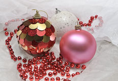 Christmas balls and red beads Stock Photo