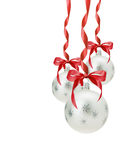 Christmas balls with red bow isolated on the white background stock photo