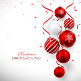 Christmas balls. Christmas red balls with ribbons and confetti Royalty Free Stock Photos