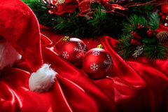 Christmas balls on red satin. Red christmas balls on red satin Royalty Free Stock Photography