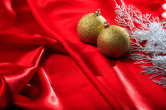 Christmas balls on red satin. Golden christmas balls on red satin Stock Images