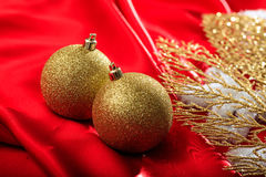 Christmas balls on red satin. Golden christmas balls on red satin Stock Photo