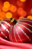 Christmas balls on red silk Stock Photos