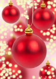 Christmas balls on red sparkling background Stock Image