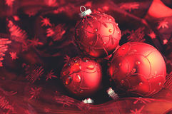 Christmas balls on red table cloth Royalty Free Stock Photos