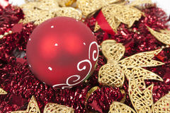 Christmas balls on red tinsels like a background Royalty Free Stock Image