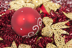 Christmas balls on red tinsels like a background Stock Image