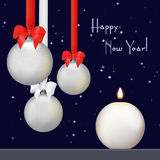 Christmas balls with red and white ribbon and bows with candle on the snowflake background. Happy New Year Christmas Royalty Free Stock Photo