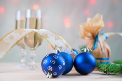 Christmas balls, ribbon, present and glasses of champagne Stock Image