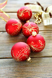 Christmas balls with ribbon on wooden boards Royalty Free Stock Photo