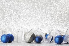 Christmas balls and ribbons. Decoration on shiny silver background royalty free stock photos