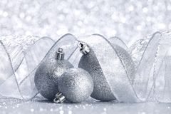 Christmas balls and ribbons. Decoration on shiny silver background stock photo