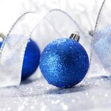Christmas balls and ribbons. Decoration on shiny silver background royalty free stock photo