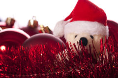 Christmas: balls, ribbons and teddy bear. Isolated on white background Stock Image