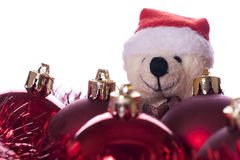 Christmas: balls, ribbons and teddy bear. Isolated on white background Royalty Free Stock Photos