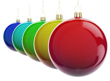 Christmas balls in a row. Multi-colored Christmas balls hanging on white. 3d render with HDR Royalty Free Stock Images