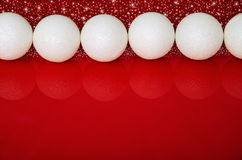 Christmas balls in a row and red space for text Stock Photo
