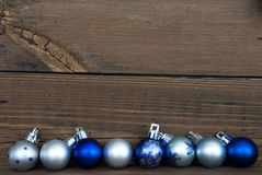 Christmas Balls in a Row on Wood with Copy Space Royalty Free Stock Photography