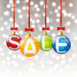 Christmas balls with sale message Royalty Free Stock Photo