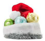 Christmas balls with Santa Clause hat isolated on the white back Royalty Free Stock Photo