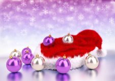 Christmas balls with santa red hat on bokeh background. 3D illustration Stock Photos
