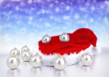 Christmas balls with santa red hat on bokeh background. 3D illustration Royalty Free Stock Photo