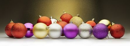 Christmas balls and stardust. Christmas balls set against  a golden stardust background. Large horizontal layout for banners Royalty Free Stock Photography