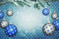 Christmas balls. Set of blue and silver balls with snowflake pattern hang on a snowy fir branch. Christmas and New Year background with copy space. 3D Stock Images