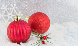 Christmas balls on shiny silver background. Red Christmas balls on shiny silver background royalty free stock images