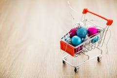 Christmas balls in shopping cart Stock Photos