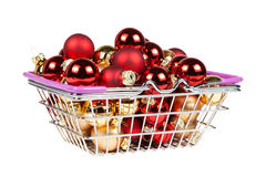 Christmas balls in the shopping cart isolated on white Royalty Free Stock Images