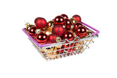 Christmas balls in the shopping cart isolated on white Royalty Free Stock Photo
