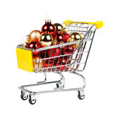 Christmas balls in the shopping cart isolated on white Stock Photos