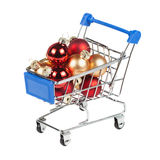 Christmas balls in the shopping cart isolated on white Stock Photo