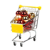 Christmas balls in the shopping cart isolated on white Royalty Free Stock Photography