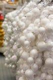 Christmas balls in shopping cart at supermarket Royalty Free Stock Photos