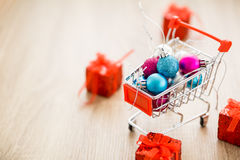 Christmas balls in shopping cart Royalty Free Stock Photos