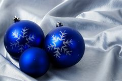 Christmas balls on a silver background Stock Image