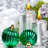 Christmas balls and silver candles Stock Images