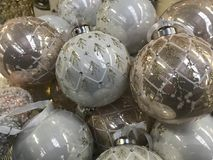 Christmas balls in silver and light brown Stock Image