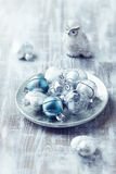 Christmas balls on a silver plate Royalty Free Stock Photo