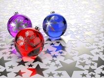 Christmas balls on silver stars Stock Photos
