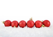 Christmas balls. Six red christmas balls with snow Royalty Free Stock Photography