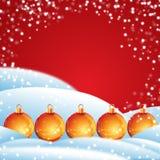 Christmas balls with snow. Orange christmas balls with snow Stock Image